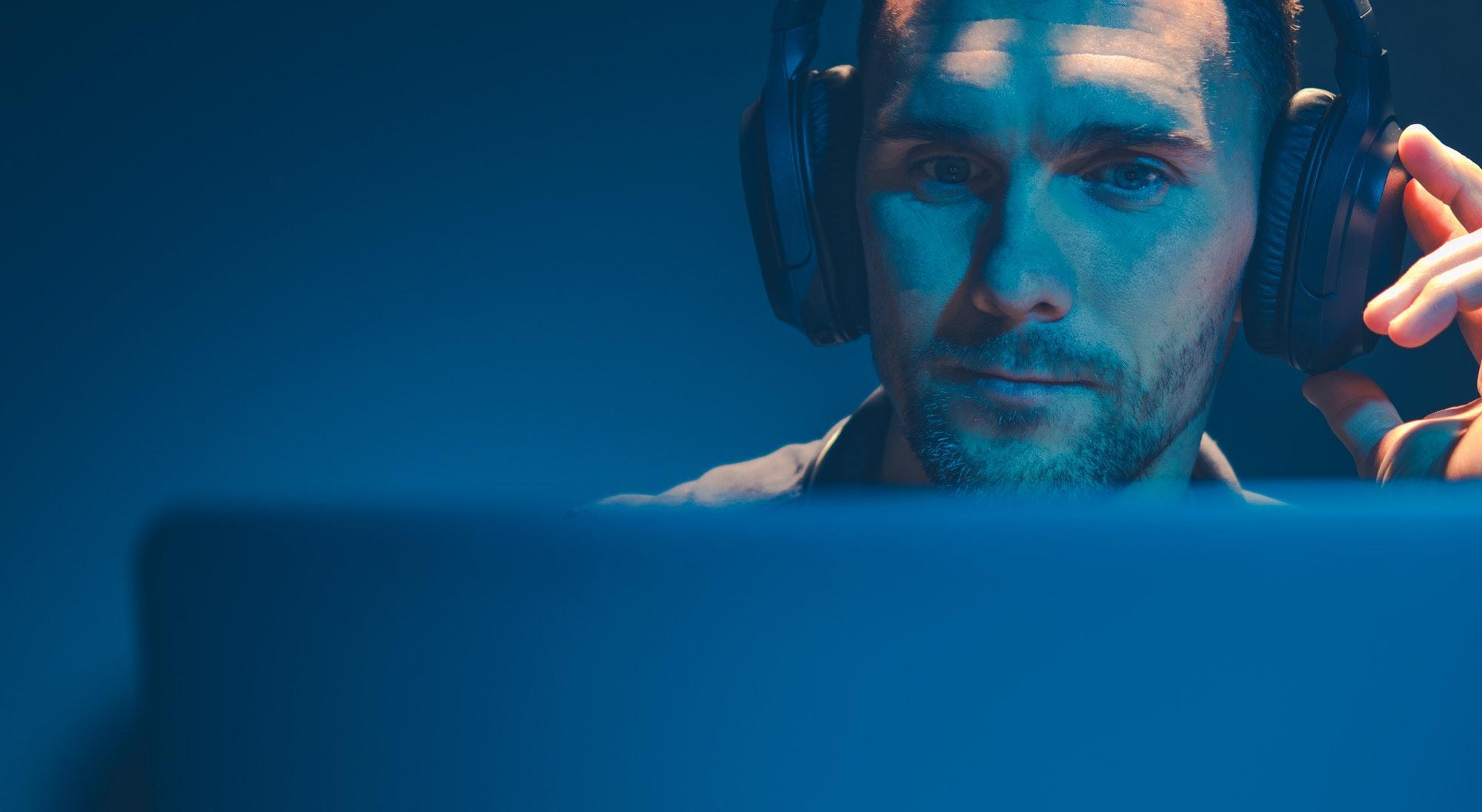Men Listening Podcast on His Wireless Headphones