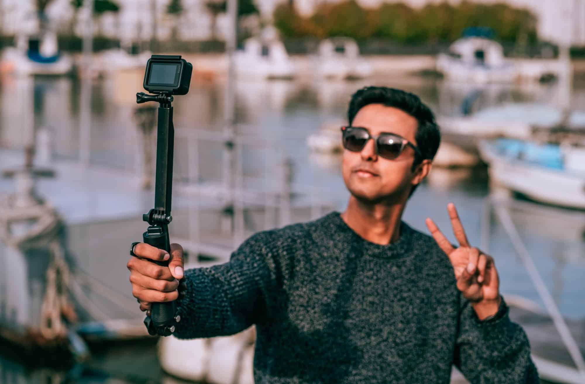 Boy using a selfie stick to take a selfie